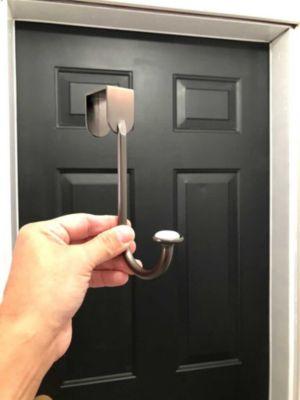 man holding hook in front of doorway
